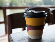 Paper coffee cup. Closeup paper coffee cup on wooden table Stock Photo