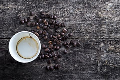 Paper coffee cup with coffee beans Stock Images
