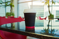Paper coffee cup mock up template over modern background Royalty Free Stock Photo