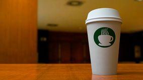 Paper Coffee Cup in Office Stock Images