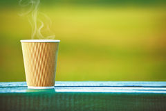 Paper coffee cup outside Royalty Free Stock Photography