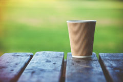 Paper coffee cup outside Royalty Free Stock Photos