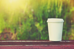 Paper coffee cup outside Stock Images