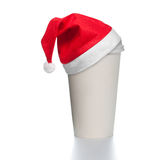 Paper coffee cup with santa hat Royalty Free Stock Photos