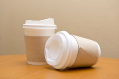 Paper coffee cup on the table Stock Images