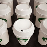 Paper Coffee Cups in Rows Stock Photography