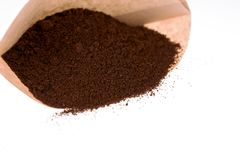Paper coffee filter with ground coffee. Unbleached paper coffee filter with ground coffee Stock Image
