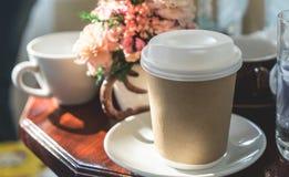 Paper coffee mug on table morning light. Paper coffee mug on table in morning light Stock Image
