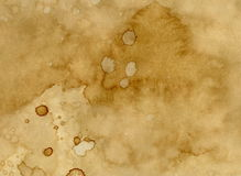 Paper with coffee stains. Worn paper with coffee stains. Background with room for text or images stock photo