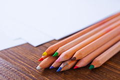 Paper and color pencils Stock Images