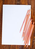 Paper and color pencils Royalty Free Stock Photos