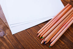 Paper and color pencils Stock Photos