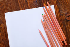 Paper and color pencils Stock Photography