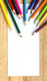 Paper and color pencils on table Royalty Free Stock Photography