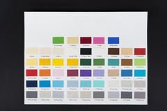 Paper color sampler with numbers on black. royalty free stock image