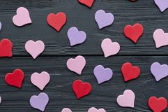 Paper colored hearts on grey wooden background royalty free stock photos