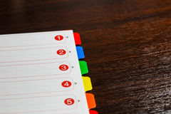 Paper with colored numbers Stock Images