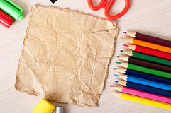 Paper and colored pencils Stock Images
