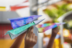 Paper colorful planes. Photograph of some paper colorful planes on ready to fly on children hands royalty free stock photo
