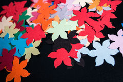 Paper colorful shapes on a black background Stock Image
