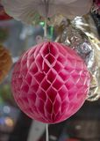 Paper colorful sphere ornament. Hanging in pink color and have patterns royalty free stock images