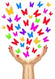 Paper colorfull butterflies fly from woman hands Royalty Free Stock Photography