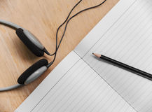 Paper for composer with pencil and headphone Stock Photo