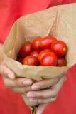 Paper cone full of cherry tomatoes Stock Photo