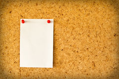 Paper on the cork board Royalty Free Stock Images