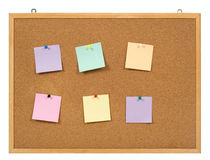 Paper on cork notice board. Royalty Free Stock Photo