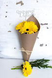 Paper cornet with a bouquet of yellow gerber Stock Images