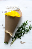 Paper cornet with a bouquet of yellow gerber Royalty Free Stock Photo