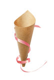 Paper cornet with pink ribbon Stock Images