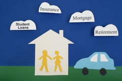 Paper couple expenses. Paper cutout couple with house and car, with financial related cloud messages Royalty Free Stock Photo