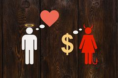 Paper couple, love vs money. Abstract conceptual image