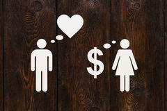 Paper couple, love vs money. Abstract conceptual image Stock Image
