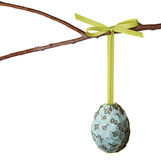 Paper covered easter egg hanging from a branch Stock Photography