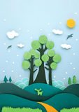 Paper craft. Tree on hills with a blue sky made by paper stock photos