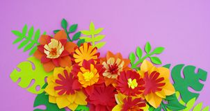 Paper craft Flower Decoration Concept. Flowers and leaves made of paper. Tropics. Pink background royalty free stock image
