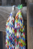 Paper Crane Chain. Two chains of colourful paper cranes hanging from a wooden door at a temple in Japan Stock Photography