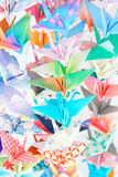 Paper Cranes. Multicolour paper birds. Soft focus and shallow depth of field. Focus on the green bird in the middle royalty free stock photo
