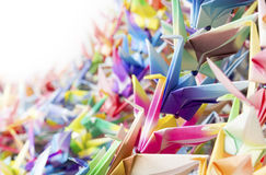 Paper cranes held together by fishing lines Stock Photography