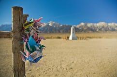 Paper Cranes at Manzanar. Colorful paper cranes hanging on a wooden post at Manzanar, California Stock Image