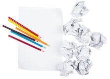 Paper with crayons and crumpled paper balls Royalty Free Stock Images