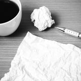 Paper and crumpled with pen and coffee cup black and white color Stock Photos