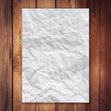 Paper crumpled on wood vertical background Stock Images