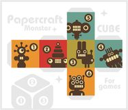 Paper cube with monsters for table games. Royalty Free Stock Images
