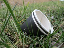Paper cup as waste in nature Stock Images