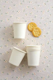 Paper cup and biscuit. Paper cup and yellow biscuit Stock Photography