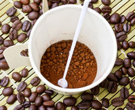 Paper cup of black coffee and coffee bean Stock Image